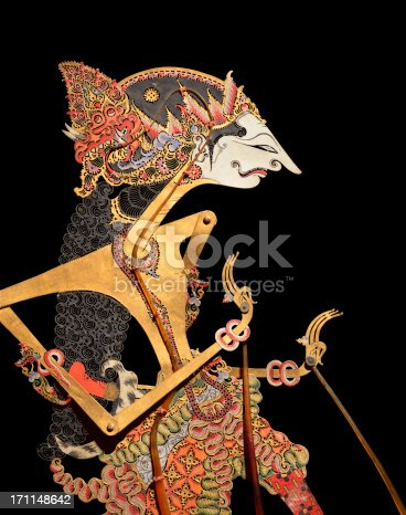 Javanese shadow puppet on black background. These puppets (Bali, early 20th century), made of buffalo hide, are used in wayang kulit aEshadow puppet playaa. The term 'wayang' was derived from Javanese word for