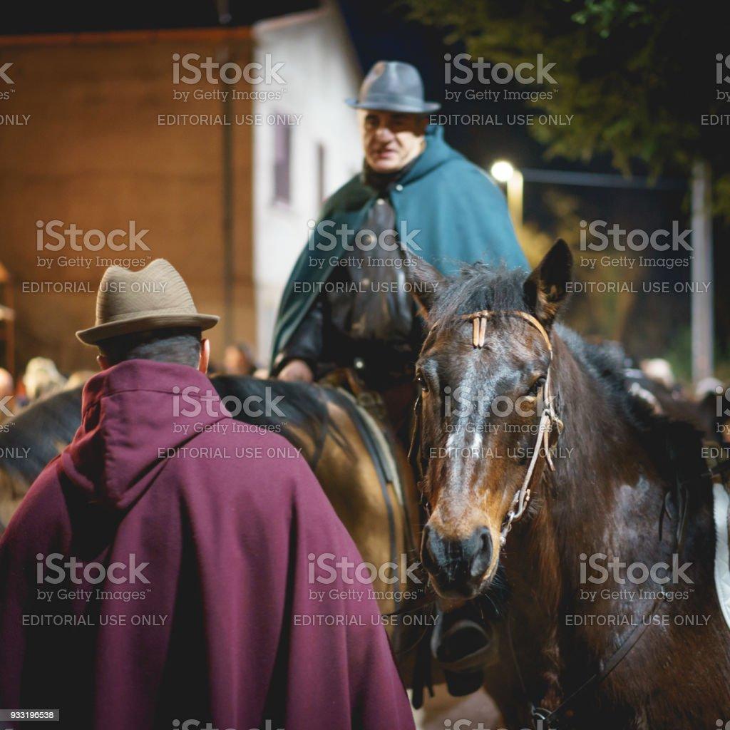 Wayfarers riding horses in a living Christmas Nativity scene reenactment. stock photo