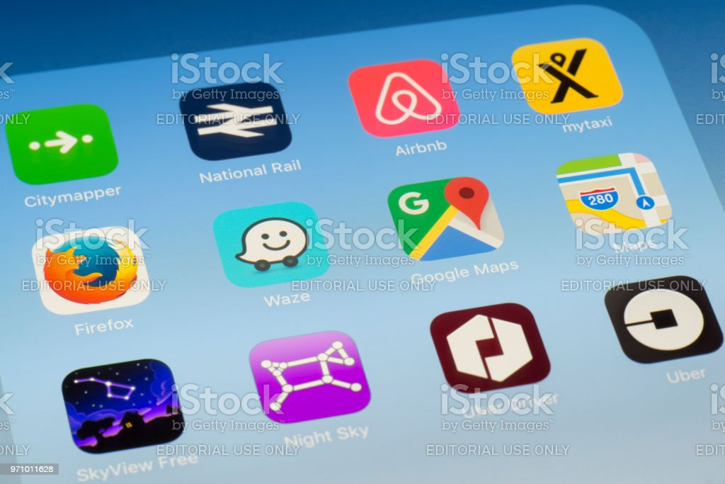 Waze, Google Maps and other travel Apps on iPad screen stock photo