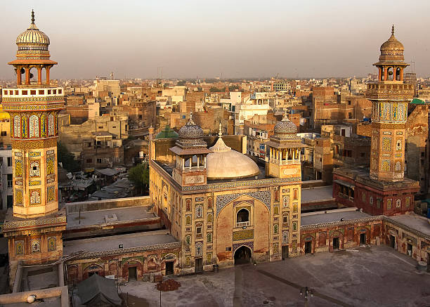 Wazir Khan mosque, Lahore, Pakistan Rooftop view from the Wazir Khan Mosque built in 1635. A masterpiece of the moghul architecture and a historic landmark in old Lahore lahore pakistan stock pictures, royalty-free photos & images