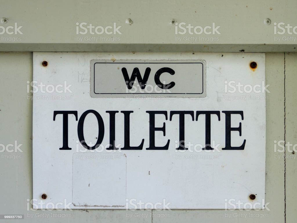 wc toilet - black lettering on a white background - foto stock