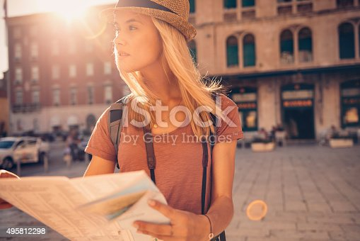 Shot of a young woman looking at a map while touring a foreign cityhttp://195.154.178.81/DATA/i_collage/pu/shoots/805861.jpg