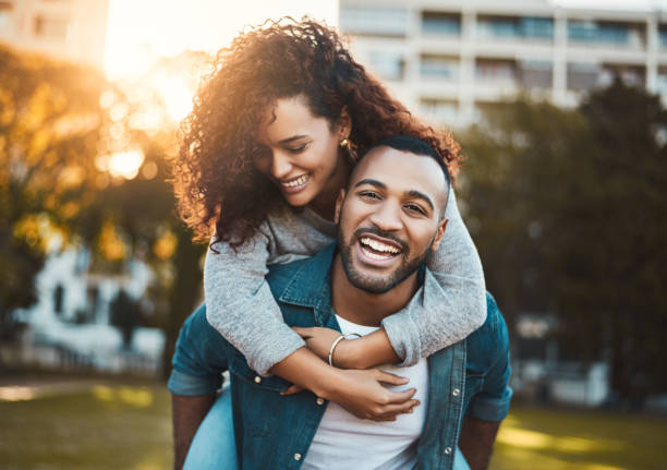 We always have a good time together Shot of a young couple having fun together outdoors piggyback stock pictures, royalty-free photos & images
