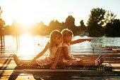 Two sisters having fun near the lake.