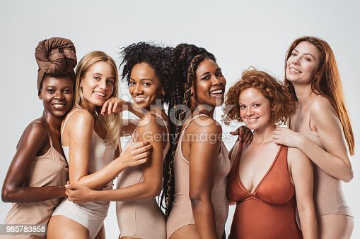Group of women with different body type in underwear, studio shot.