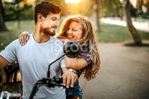 Couple using electric vehicle