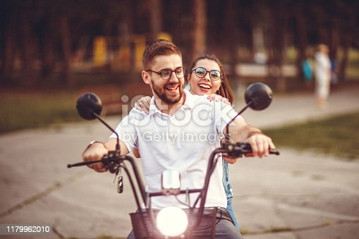 Couple using electric vehicle