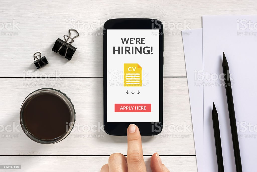 We are hiring apply now concept on smartphone screen stock photo