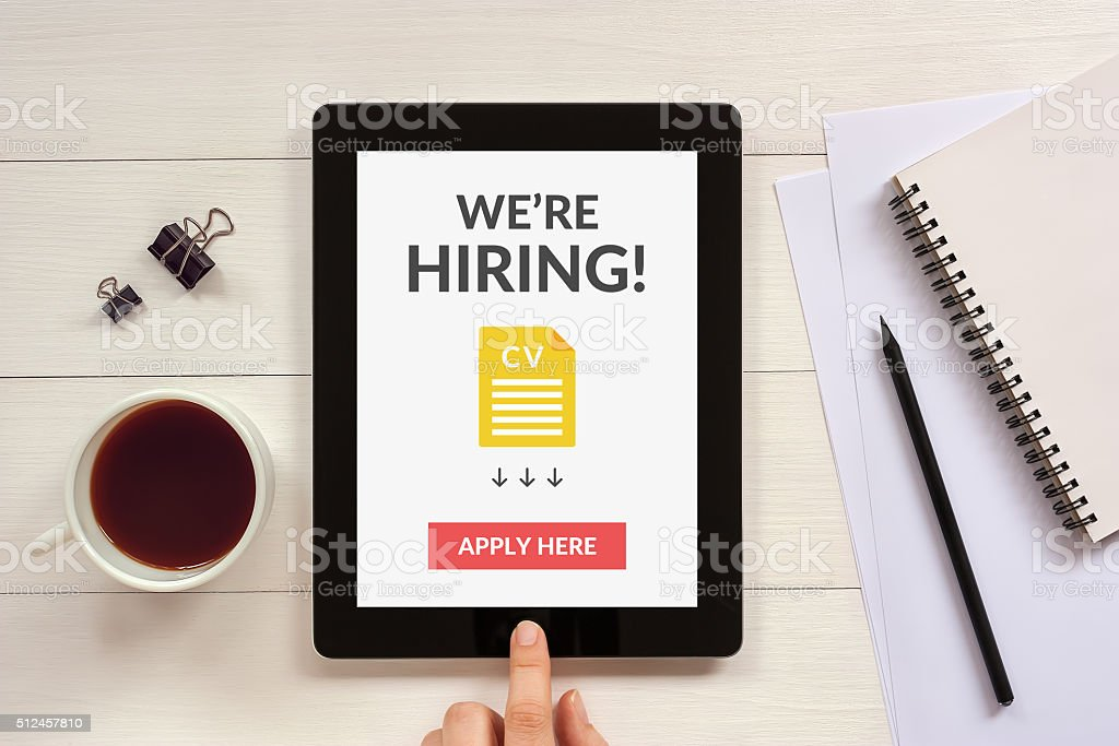 We are hiring apply now concept on tablet screen stock photo