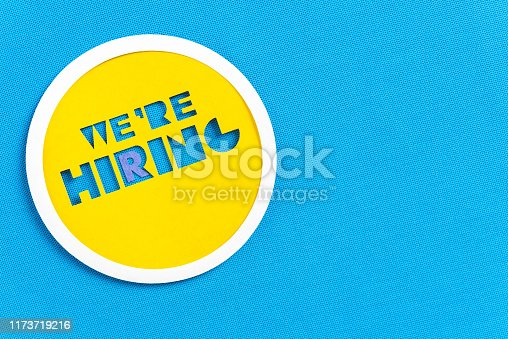istock We are hiring circle sign button design on blue textured background with space for text 1173719216