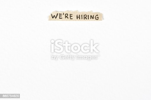 1153648747 istock photo We are hiring handwritten billboard at the top on textured white background 885754620