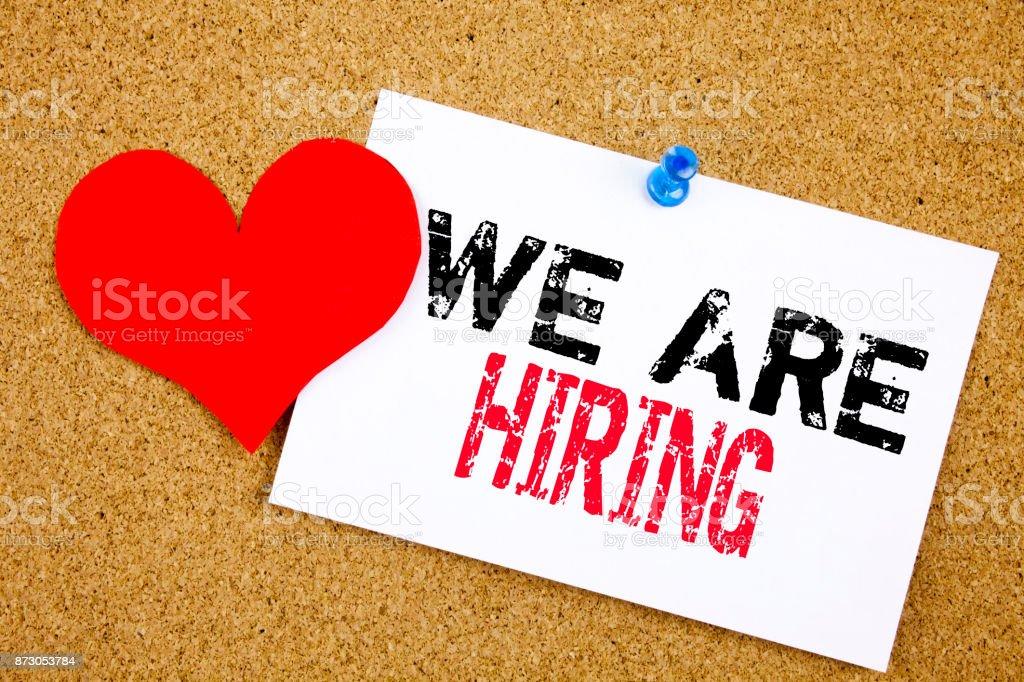 We are Hiring handwritten with white chalk on a sticky note stock photo