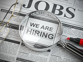 We are hiring. Job search and employment concept. Magnified glass with jobs classified ads in newspaper, 3d illustration