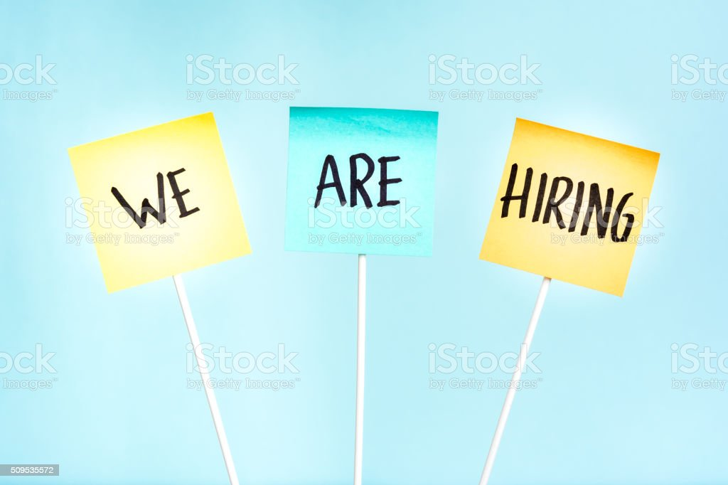 we are hiring signpost stock photo