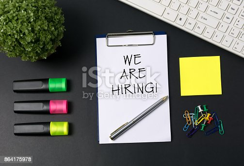 477419728istockphoto We Are Hiring Word on Placard 864175978