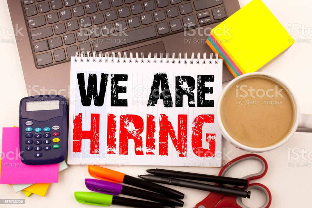 We Are Hiring Writing text in the office with surroundings such as laptop, marker, pen, stationery. Business concept for Recruitment and Job recruiting advertisement white background with copy space stock photo
