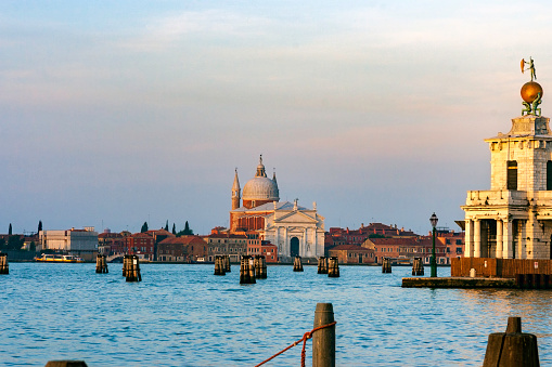 We are looking across the Venetian Lagoon just after dawn toward the facade of the Benedictine church and the San Giorgio Maggiore island of the same name.