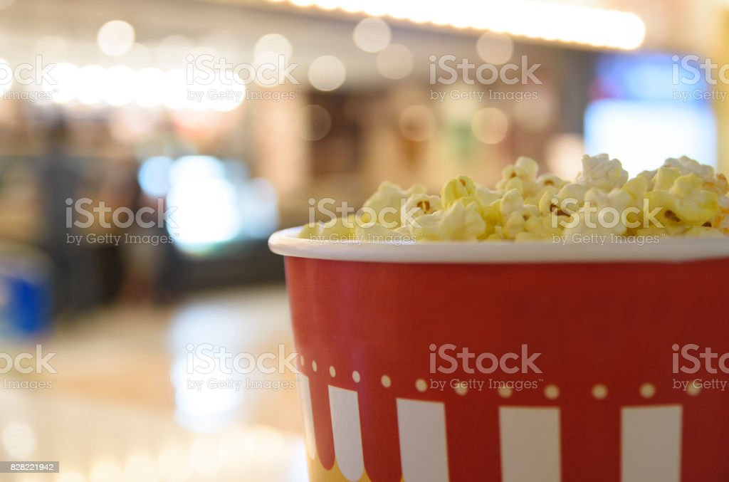 We are waiting with popcorn before the movie starts. stock photo