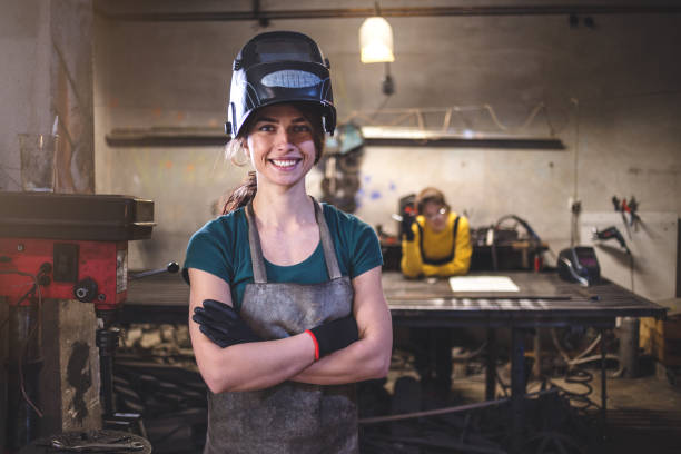 We can do it Young sisters working in their workshop together, welding and cutting things out of metal. metal worker stock pictures, royalty-free photos & images