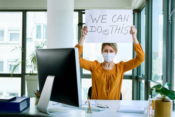 We can do this! Businesswoman holding placard with we can do this text as support during virus epidemic. prevention stock pictures, royalty-free photos & images