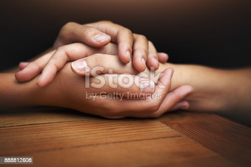 Cropped shot of two unrecognizable people holding hands in comfort