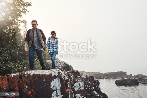 Shot of a young couple out for a walk in nature