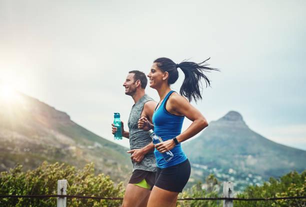 we compete in a friendly way - бег трусцой стоковые фото и изображения