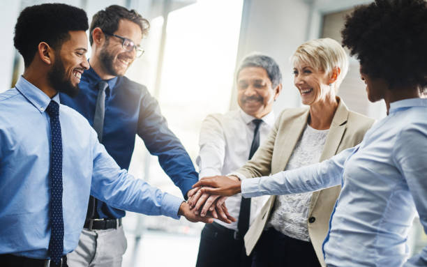We decide our own success Cropped shot of a group of businesspeople putting their hands together in unity loyalty stock pictures, royalty-free photos & images