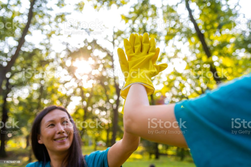 Volunteering, unity and environment care concept. Photo of two young...