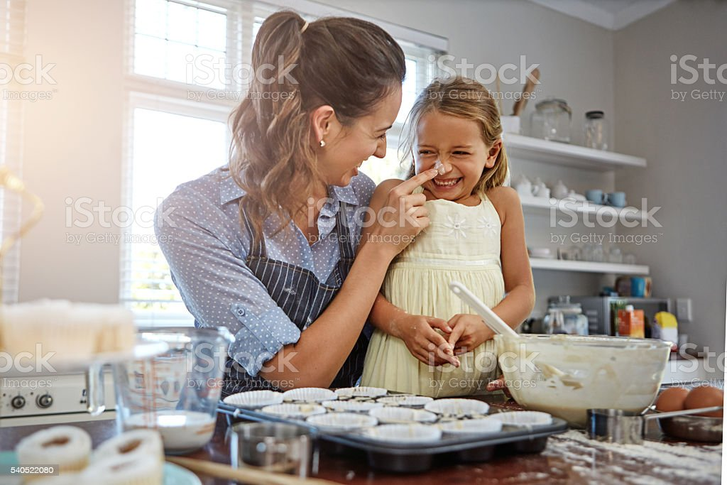 We have so much fun when baking stock photo