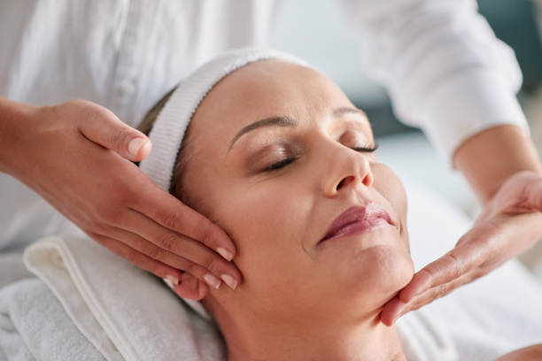 We just want to help you banish wrinkles Shot of a mature woman getting a facial treatment at a spa pampering stock pictures, royalty-free photos & images