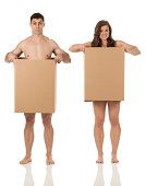 istock We lost everything! Naked couple in cardboard boxes 174959197