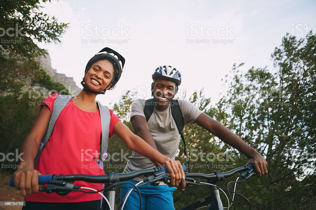 We love cycling together! stock photo