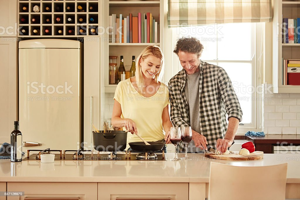 We love getting into the kitchen together stock photo