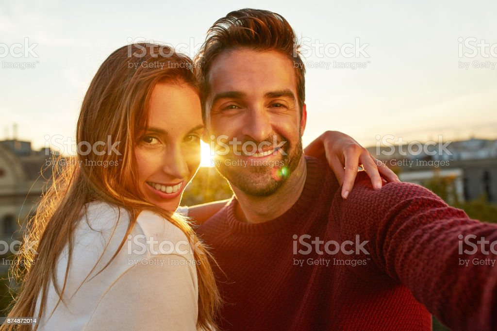 Cropped shot of a happy couple taking a selfie while out on a date