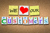 istock We love our customers on wooden cork billboard with pins 500831066