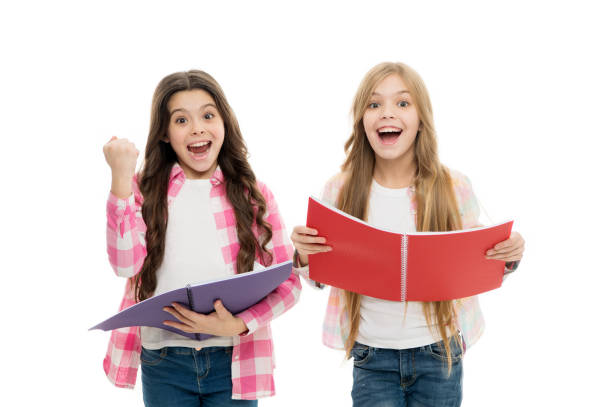 We love study. Studying is fun. Buy book for extra school course. Language courses for youth. Girls with school textbooks white background. School concept. Pupils carrying textbooks to school classes stock photo