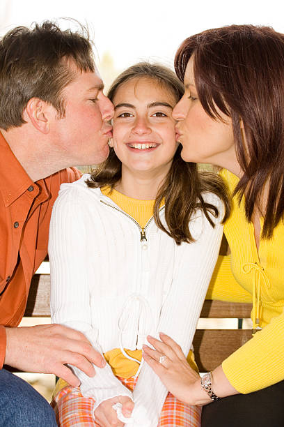 We Love you!  little girl kissing dad on cheek stock pictures, royalty-free photos & images