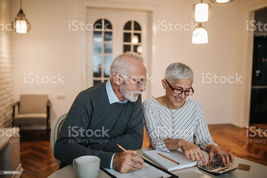 We might just be able to afford that vacation! stock photo