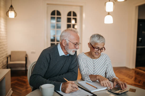 we might just be able to afford that vacation! - retirement stock photos and pictures