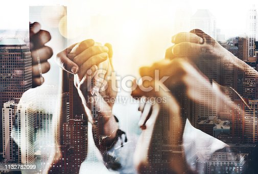 Closeup shot of a group of businesspeople holding hands together in solidarity