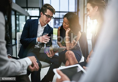 Shot of a group of colleagues having a meeting in a modern office