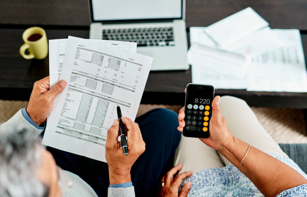We need to make all our numbers balance High angle shot of a couple calculating their finances together at home expense stock pictures, royalty-free photos & images