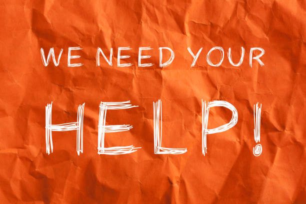 """We Need Your Help """"We need your help!"""" text on wrinkled lined paper. Business concept. weakness stock pictures, royalty-free photos & images"""