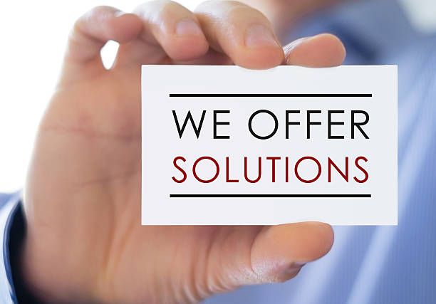 we offer solutions - business card - business symbols stock photos and pictures