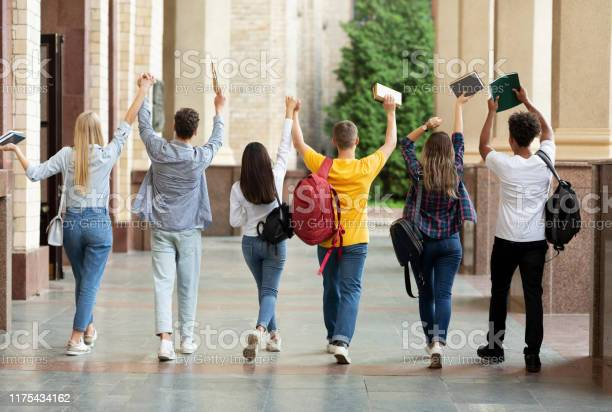 We passed exams students raised hands and walking in campus picture id1175434162?b=1&k=6&m=1175434162&s=612x612&h=pk tnjozktirjfzzwnejy6wr2l9kzlbtixyp44xmq4e=