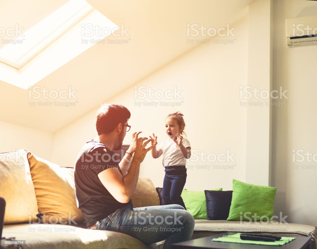 We pretend to be monsters ... Grrr, I am so scary stock photo