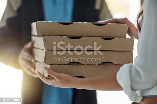 Cropped shot of a man making a pizza delivery to a customer