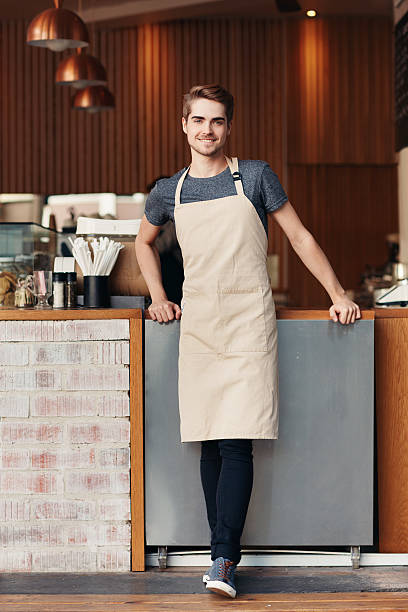 we serve the best coffee in town - apron stock pictures, royalty-free photos & images