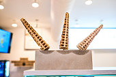 Shot of waffles in the shape of a cone on a display stand at an ice cream parlour